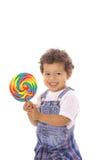 Niño feliz con el lollipop grande Foto de archivo libre de regalías
