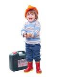Niño feliz con las herramientas de funcionamiento Fotografía de archivo