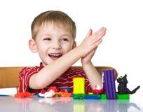 Niño feliz con plasticine Fotografía de archivo libre de regalías