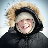 Niño feliz en el invierno Fotografía de archivo libre de regalías