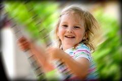 Niño feliz en el oscilación Imágenes de archivo libres de regalías