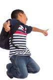 Niño feliz porque es de nuevo a tiempo de la escuela Imagen de archivo libre de regalías