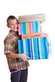 Niño feliz que lleva muchos regalos Fotografía de archivo libre de regalías