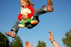 Niño feliz que vuela Imagen de archivo libre de regalías