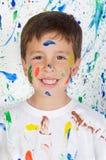 Niño feliz y pintado Imagen de archivo libre de regalías
