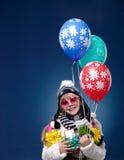 Niño femenino feliz con los globos Imagen de archivo libre de regalías