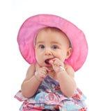 Niño femenino lindo con la piruleta imagen de archivo