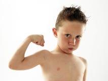 Niño fuerte. foto de archivo