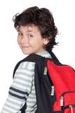 Niño hermoso del estudiante con el morral pesado imágenes de archivo libres de regalías
