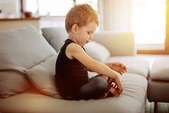 Niño hermoso que juega con su juguete Fotografía de archivo libre de regalías