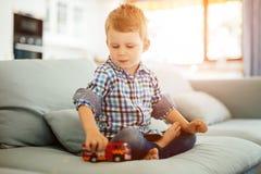 Niño hermoso que juega con su juguete Imagen de archivo