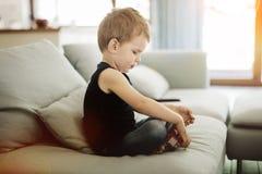 Niño hermoso que juega con su juguete Imagen de archivo libre de regalías