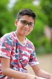 Niño indio en la lente Imagen de archivo libre de regalías