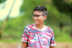 Niño indio en la lente Imágenes de archivo libres de regalías