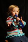 Niño joven con la flauta musical 3 Fotos de archivo
