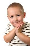 Niño joven con las manos contra su cara Imagen de archivo