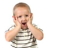 Niño joven dado una sacudida eléctrica y sorprendido Fotos de archivo
