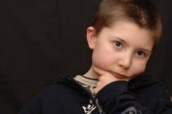 Niño joven hermoso.   Fotos de archivo