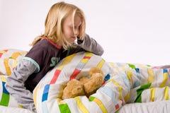 Niño joven que despierta Fotografía de archivo libre de regalías