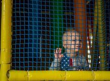Niño, jugando, patio Foto de archivo libre de regalías