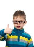 Niño lindo con el pulgar para arriba Imágenes de archivo libres de regalías