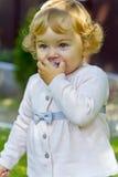 Niño lindo con la entrerrosca Imagen de archivo