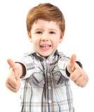 Niño lindo con los pulgares para arriba imagen de archivo