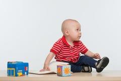 Niño lindo con un libro Imágenes de archivo libres de regalías