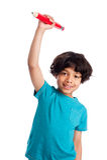 Niño lindo de la raza mixta con el lápiz gigante. Fotografía de archivo