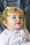 Niño lindo en rosa fotografía de archivo