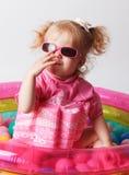 Niño lindo en un traje de baño protector Fotografía de archivo