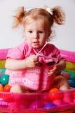 Niño lindo en un traje de baño protector del flotador Fotos de archivo