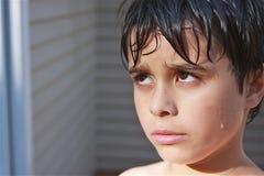 Niño mojado, hosco Foto de archivo libre de regalías