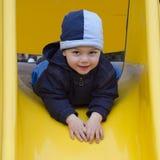 Niño en el patio. Fotografía de archivo libre de regalías