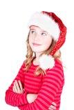 Niño o muchacha adolescente que lleva un sombrero de Papá Noel Fotos de archivo libres de regalías