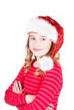 Niño o muchacha adolescente que lleva un sombrero de Papá Noel Imagen de archivo