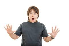 Niño o muchacho rechoncho caucásico joven que gesticula la sorpresa que se sostiene hola fotografía de archivo