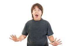 Niño o muchacho rechoncho caucásico joven que gesticula sorpresa Imagen de archivo libre de regalías