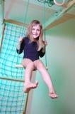 Niño palying con la gimnasia casera Fotografía de archivo libre de regalías