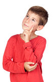 Niño pensativo con el pelo rubio Fotografía de archivo