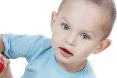 Niño pequeño adorable en blanco Imagenes de archivo