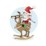 Niño pequeño como reno de madera del paseo de santa La Navidad, Año Nuevo Imágenes de archivo libres de regalías