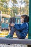 Niño pequeño con el auricular Foto de archivo libre de regalías