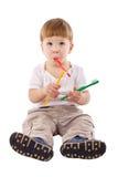 Niño pequeño con el cepillo de dientes en la boca Imagen de archivo libre de regalías
