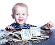 Niño pequeño con el dinero Foto de archivo