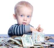 Niño pequeño con el dinero Fotografía de archivo libre de regalías