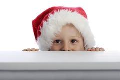 Niño pequeño con el sombrero de Navidad Fotos de archivo libres de regalías