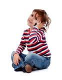 Niño pequeño con el teléfono Imagen de archivo libre de regalías