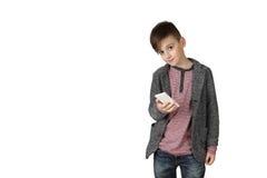 Niño pequeño con el teléfono celular Fotografía de archivo