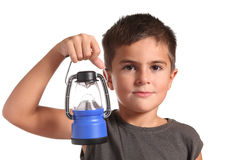 Niño pequeño con la linterna Imagenes de archivo